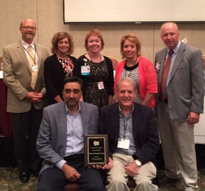 """The Illinois Telehealth Network (ITN) recently received the Illinois Rural Health Association's (IRHA) """"2016 Rural Health Award of Merit"""" at the IRHA Educational Conference and Annual Meeting on August 11 in Effingham. Accepting the award were (sitting, from left to right): Gurpreet Mander, MD, ITN chair, and chief medical officer, HSHS St. John's Hospital; David Imler, ITN board member, and board chair of Hillsboro Area Hospital; (standing, from left to right) David Mortimer, ITN administrative director, and Innovation Institute director, Hospital Sisters of St. Francis Foundation; Chris Schmidt, RN, BSN, ITN network director, and regional stroke and telemedicine nurse coordinator, HSHS St. John's Hospital; Tammy Lett, RN, MBHA, ITN Tele-Behavioral Health Committee co-chair, and chief nursing officer, HSHS Holy Family Hospital, (Greenville, IL); Margaret Vaughn, executive director, IRHA; Ryan Jennings, MD, ITN Tele-Behavioral Health Committee co-chair, and chief medical officer, HSHS St. Anthony's Memorial Hospital (Effingham, IL)."""