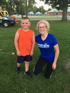 Eight-year-old Kolton Forlines poses with one of his Tom Short Kids Training Team leaders Laura Bollan at Forest Park in Shelbyville.