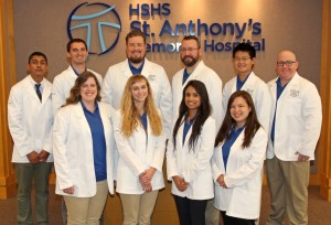 On August 29, HSHS St. Anthony's Memorial Hospital welcomed ten student doctors from Liberty University College of Osteopathic Medicine (LUCOM) who are launching their third-year clinical rotations at St. Anthony's.  Front row, from left to right: Kelley Dilliard, Laura Helgren, Pranamya Mahankali, and Marie Hewett. Back row, left to right, Sahil Vagha, Seth Streeter, Kevin Hinson, Thomas Rutherford, Eric Tam, and Rusty Davis.