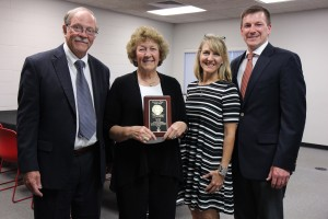The Lake Land College Board of Trustees posthumously honored Karen Fuqua with the Clem G. Phipps Exemplary Trustee Award during the August meeting at the Kluthe Center in Effingham. Fuqua's family including her sister, Marilyn Fuqua Thompson and her niece Nicole Zeller and her husband, Eric Zeller, received the award on her behalf. Pictured left to right are Gary Cadwell, chairman of the board of trustees, Fuqua Thompson, Nicole Zeller and Zeller.